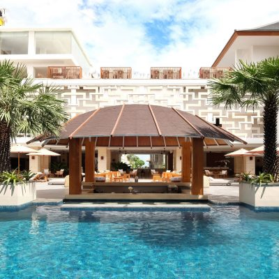 swim-up bars at tropical swimming pool The Bandha Hotel & Suites