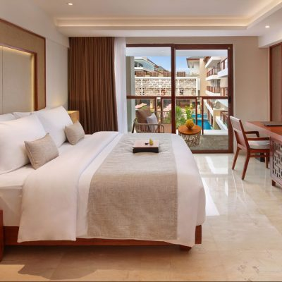 Deluxe room with Balinese accents